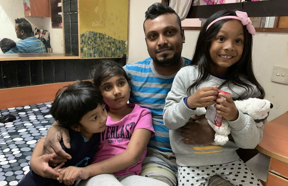 Supun Kellapatha with his children, Keana, Sethumdi, and Dinath. A family now separated.