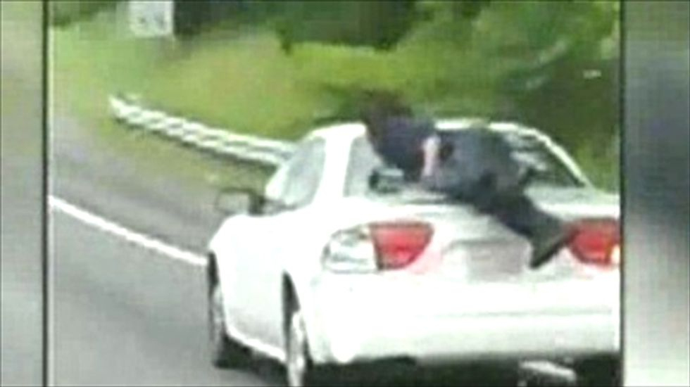 NC cops searching for mystery man caught hanging onto vehicle in highway traffic
