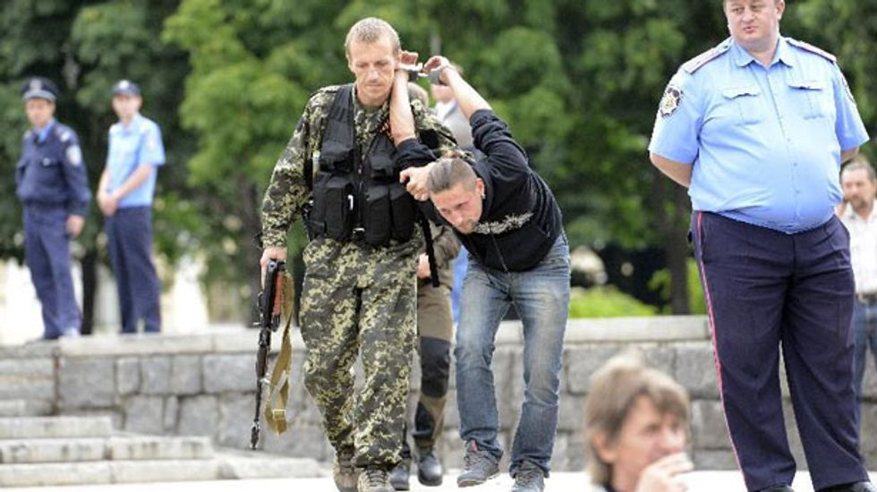 Russia denies 'humanitarian' push into Ukraine as forces surround Donetsk