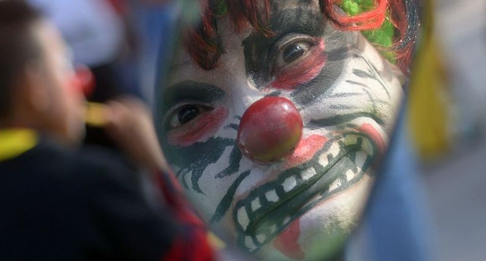 Ohio dad arrested for punishing 6-year-old girl by chasing her through neighborhood in clown mask