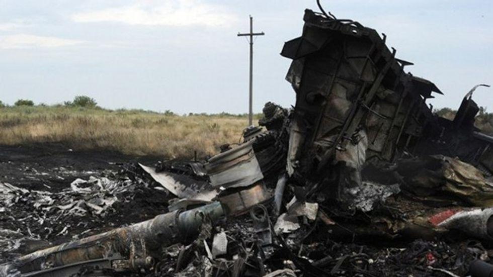 Human remains still at MH17 crash site, says Australia PM
