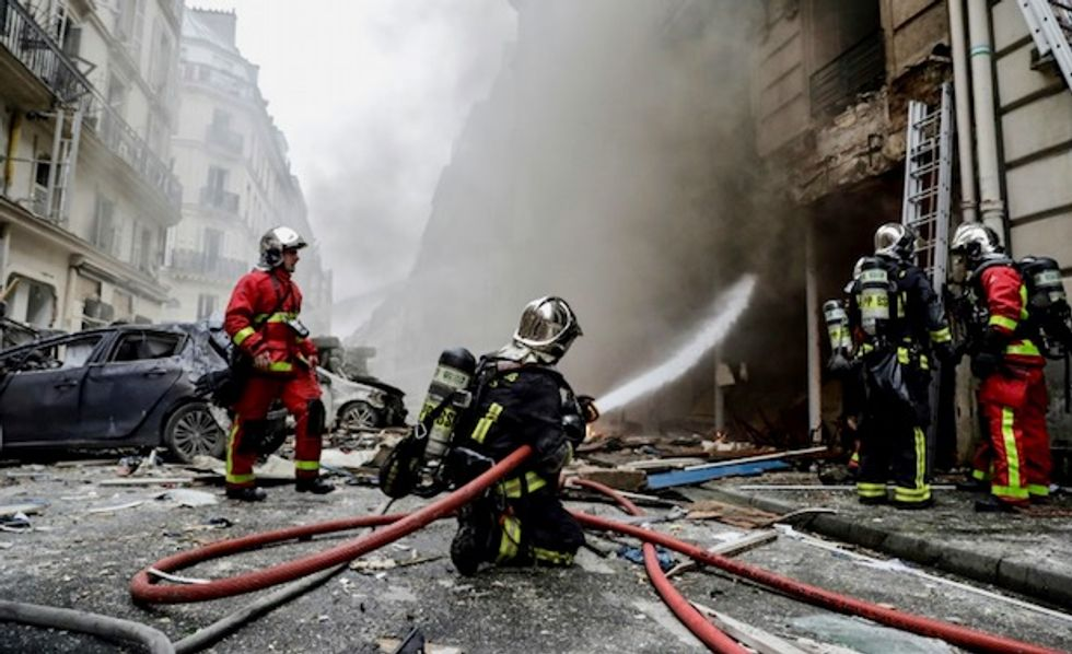 Two firefighters dead nearly50 people injured in central Paris gas blast