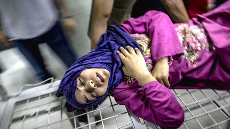 Deadly shelling hits UN school, killing 16, as Hamas mulls truce