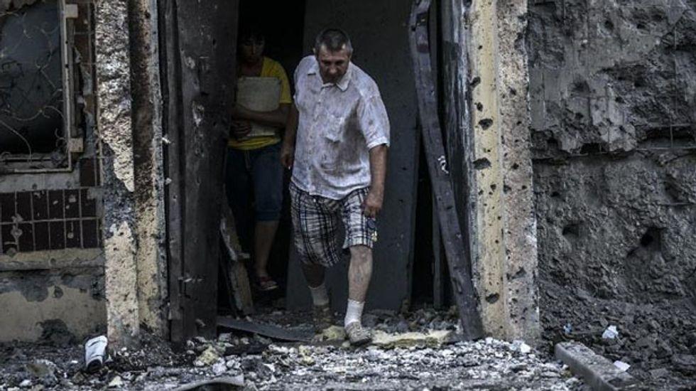 EU hits Russia with economic sanctions as fighting intensifies in Ukraine
