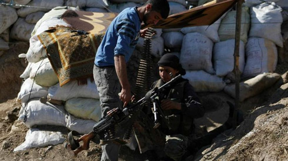 Islamic State jihadists battle with Kurds and Sunni tribes in Syria