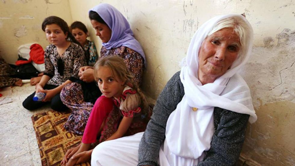 20,000 Yazidi Iraqis targeted by ISIS escape from mountain after US air strikes