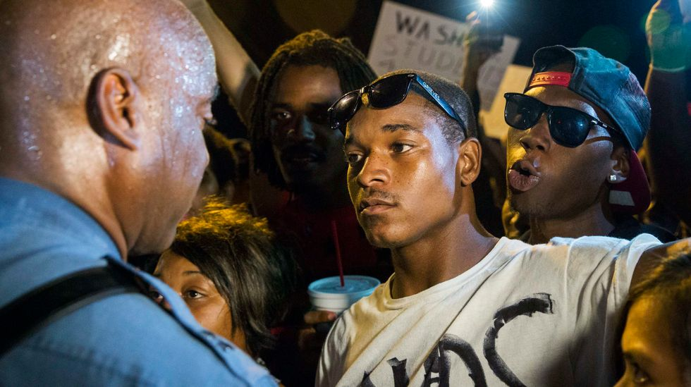 Awaiting Ferguson grand jury, activists prepare for nonviolent civil disobedience