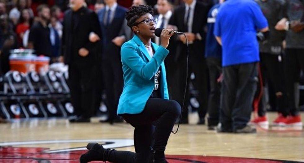Singer kneels while performing anthem at Miami NBA game