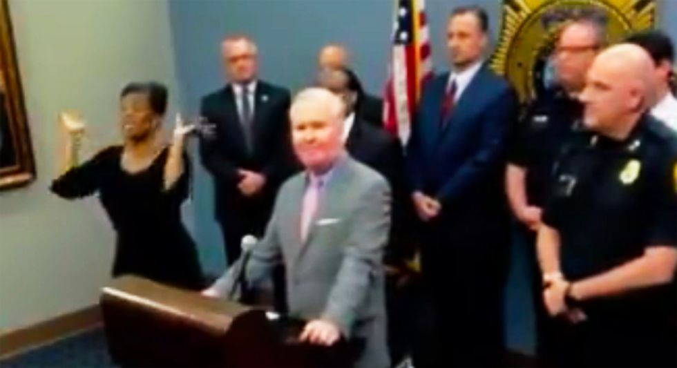 WATCH: Sign language interpreter delivers gibberish after showing up uninvited to police press conference