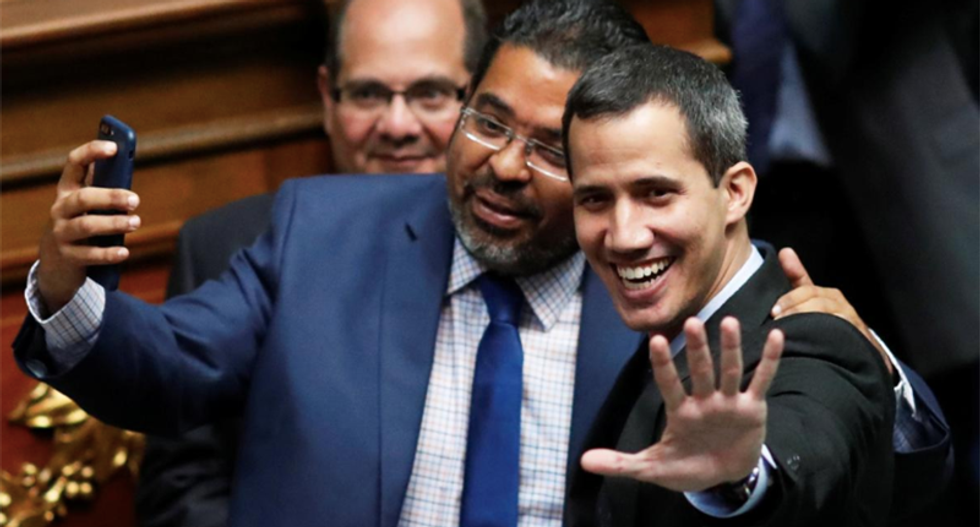 Venezuela targets Guaido with probe, travel ban and freezes assets