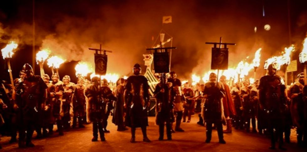Axes, armor, torches: Vikings feast on Scottish island