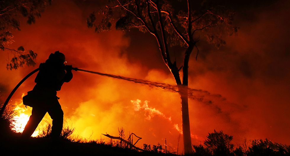 Milder weather finally helps firefighters in battle as California wildfires grow