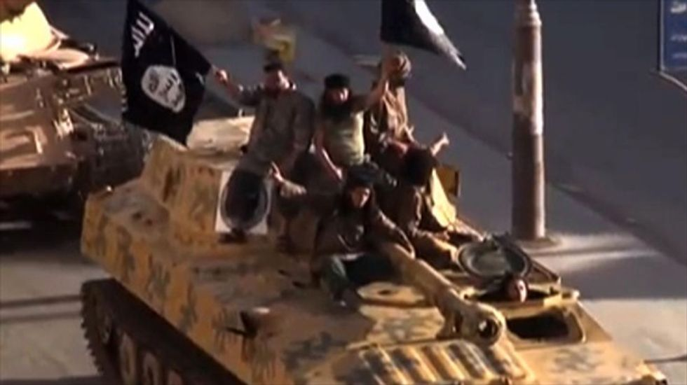 Syria jihadists tie up woman in a public square and execute her for 'adultery'