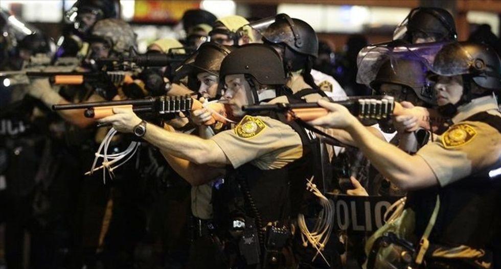 Justice Dept. chides Ferguson cops for militarized tactics against Michael Brown protesters
