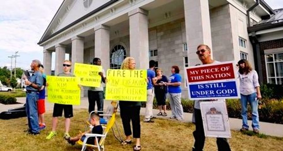 Defiant Kentucky clerk's backers want aides fired over marriage licenses to same-sex couples