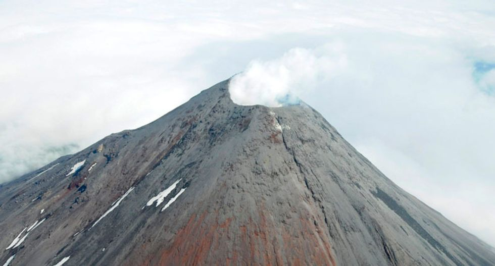 Scientists raise alert level for Alaska volcano after explosion detected