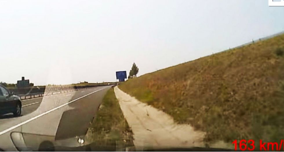 WATCH: Video catches the stomach-turning moment a motorist going over 100 mph fell asleep at the wheel