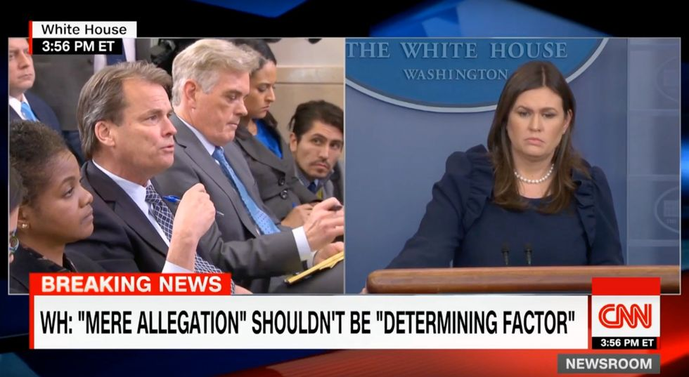 'He relayed that statement to me': Sarah Sanders melts down when asked why Trump won't condemn wife abuse