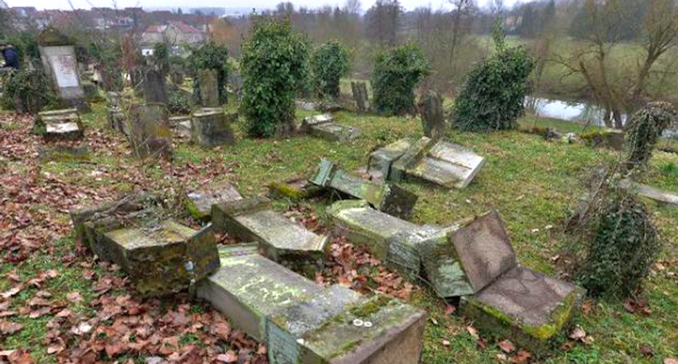 Five teens charged with vandalizing Jewish cemetery in France