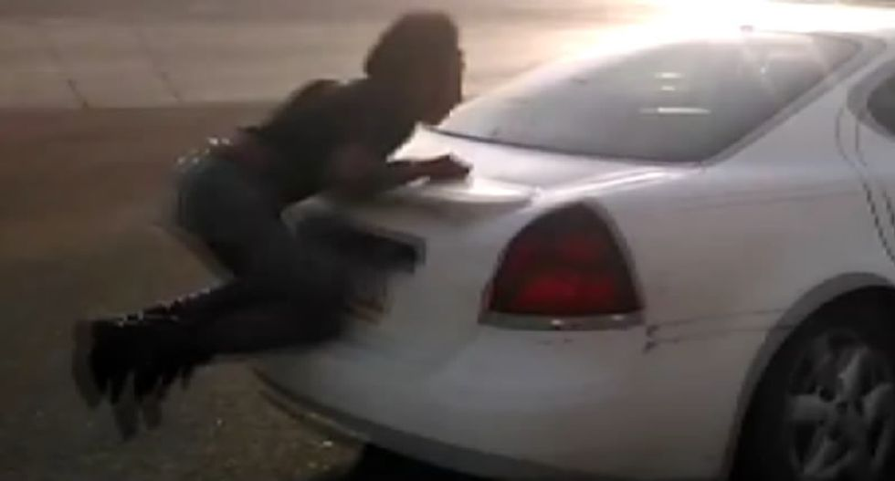 WATCH: Man clings to bumper after being run down by car in Arizona parking lot