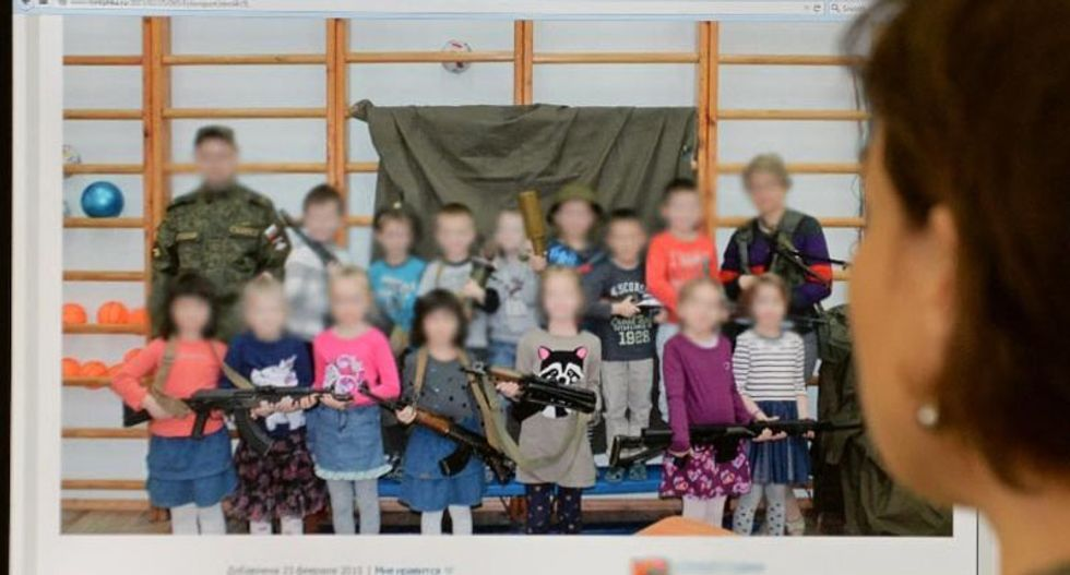 'Horrible and outrageous!' Kindergarten kids toting AK-47s ignites outrage in Russia