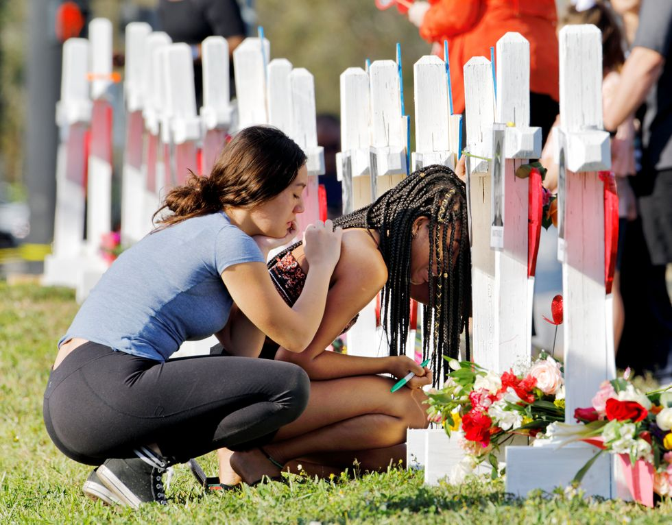 Classes to resume at Florida high school two weeks after massacre