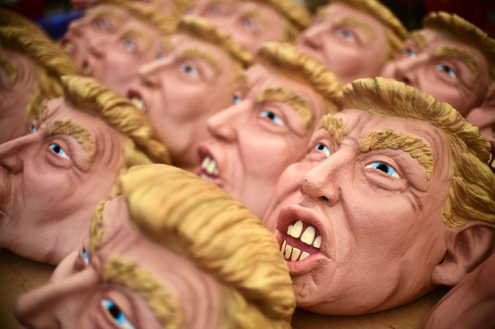 Two men wearing Trump masks 'beat the devil out of each other' at a Virginia Lowe's: witness