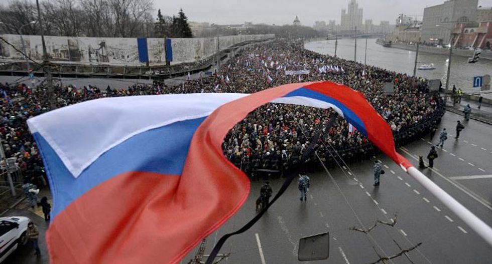 Thousands march in Moscow in memory of slain opposition leader Nemtsov