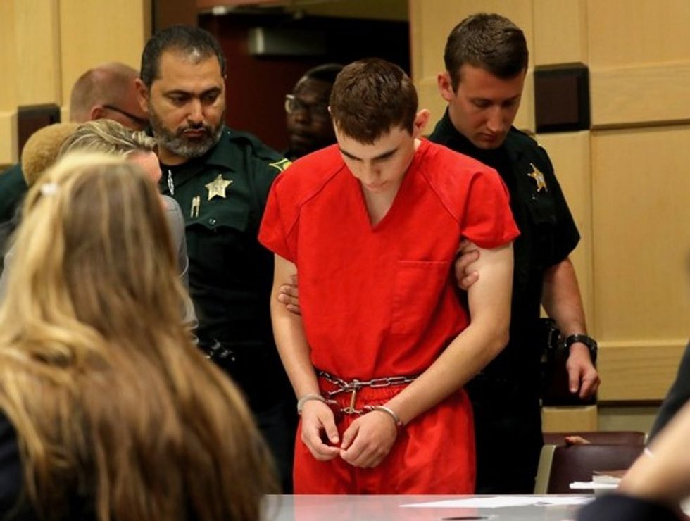 Before the massacre, the Florida high school shooter was filmed in a schoolyard brawl