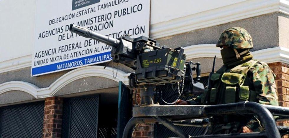 Drug cartel gunmen open fire on Mexican mayor's convoy 'by mistake'