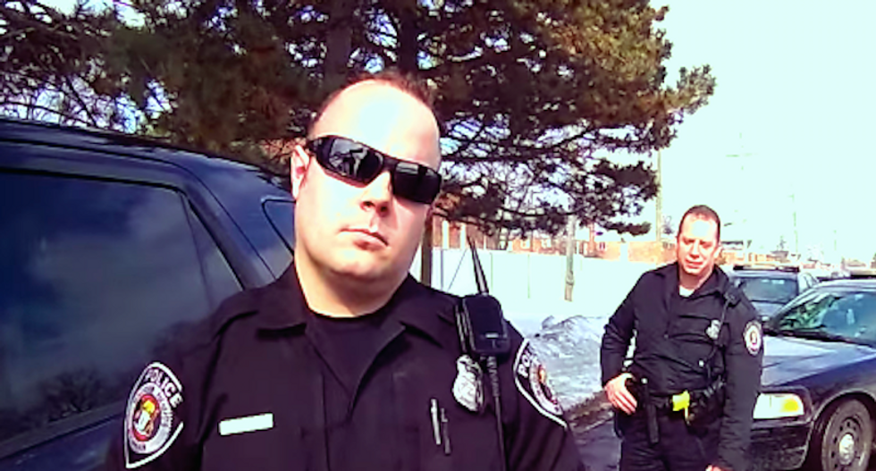 Watch this open-carry activist taunt cops outside a school: 'I'm talking to you, tough guy'