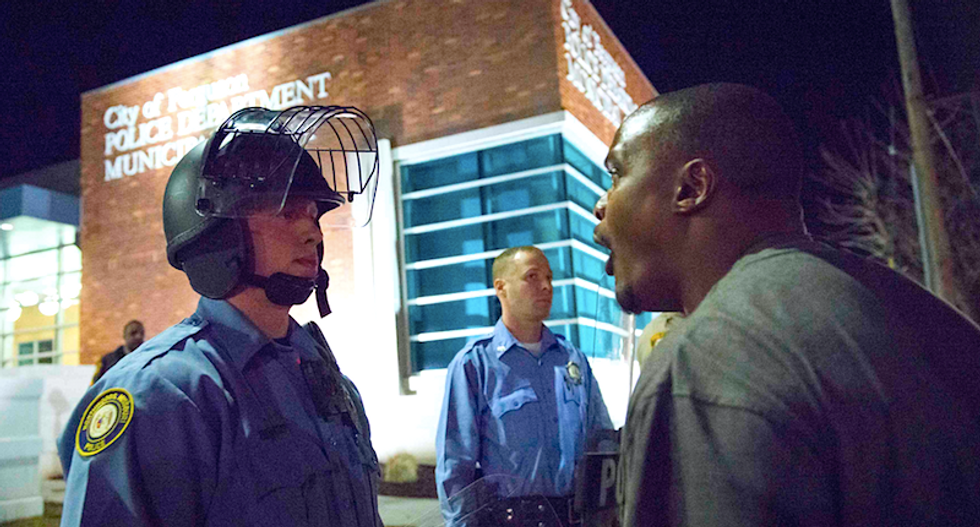 Two officers shot in Ferguson, but witnesses dispute police claims that shooter was among demonstrators