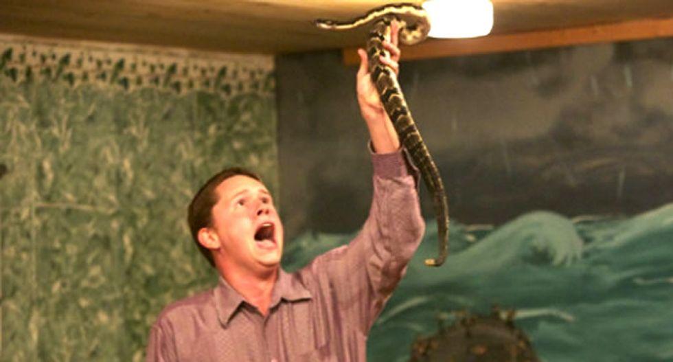 Snake-handling former reality star pastor accused of firing gun during 'domestic dispute'