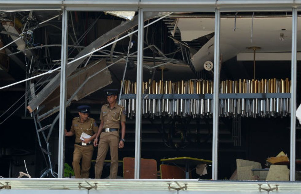 More than 130 killed as blasts hit Sri Lankan churches and hotels on Easter Sunday