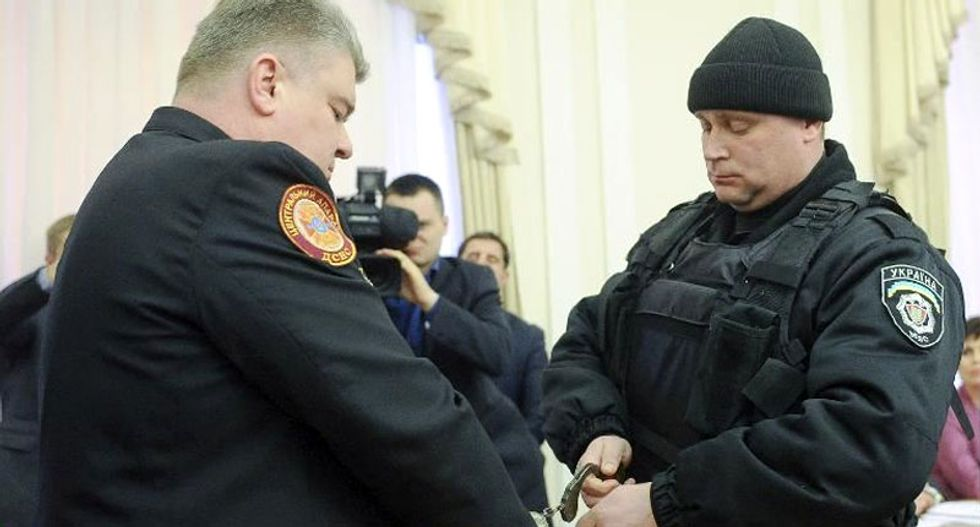 Ukraine arrests top officials on live TV, sacks powerful oligarch