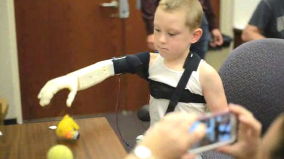 FL college students use 3-D printer and $350 in parts to create 'bionic' arm for 6-year-old boy