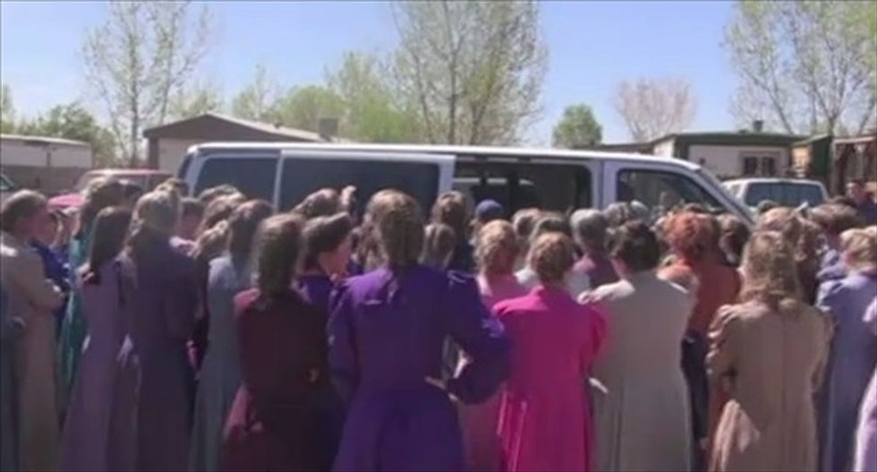 Chicken-wielding polygamist Mormon sect blocks former member from retrieving her children