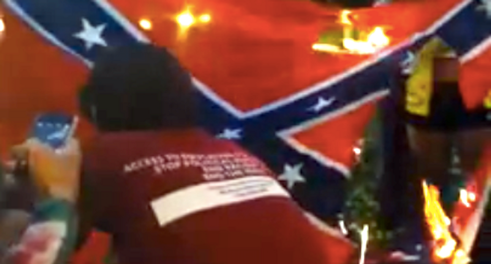 Students burn Confederate flag to protest KKK ties to racist Florida cops and prison guards