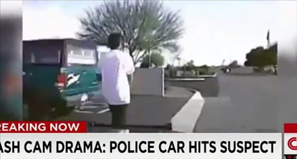 WATCH: Arizona cops run over rifle-toting suspect because they wanted to 'save his life'