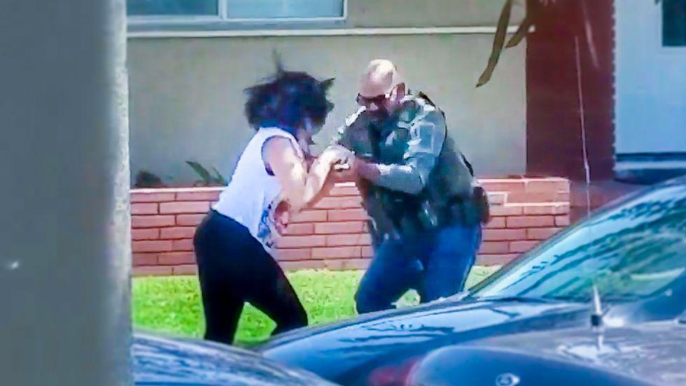 WATCH: US Marshal goes berserk smashing woman's phone for recording him on public sidewalk