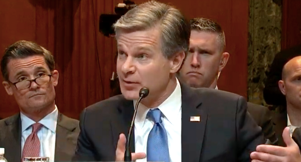 FBI director Chris Wray pushes back on Bill Barr's claims about 'spying' on the Trump campaign