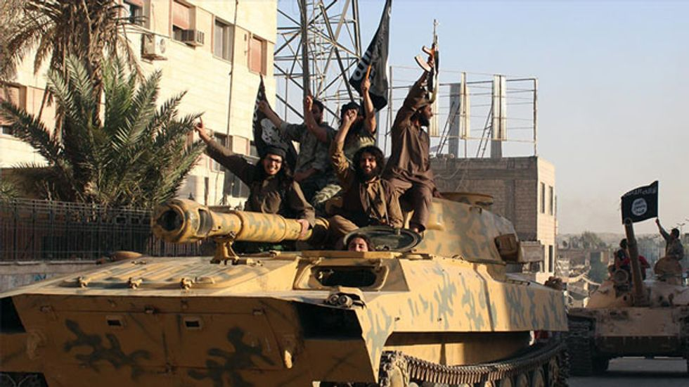 US considers air strikes and air drops to help Iraqis trapped on mountain by jihadists
