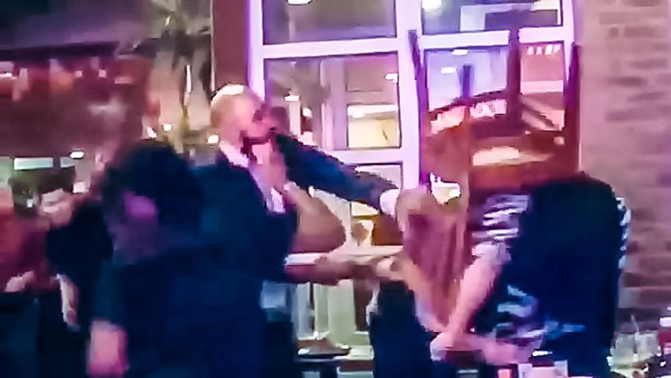 Cell phone video shows gay couple bashed over the head with chair at Dallas BBQ in Manhattan