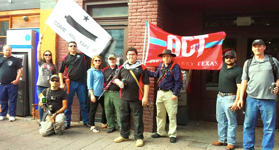 Open-carry activists mob bullet-ridden Austin police station to show guns aren't scary