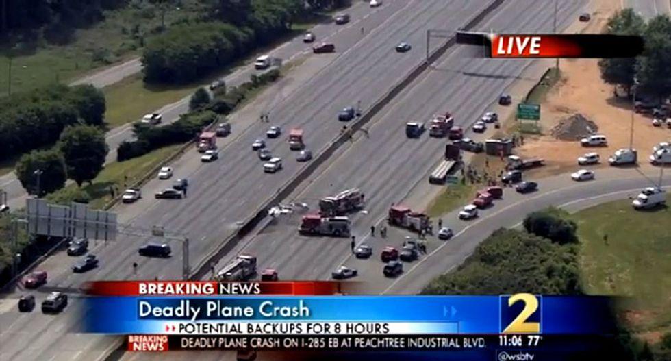 Four dead after plane crashes onto Atlanta highway