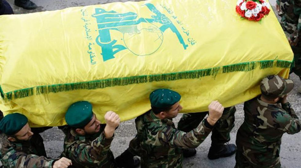 Hezbollah vows response to Israeli attack 'at the appropriate time'