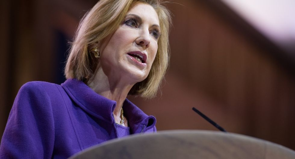 Fiorina defends Hewlett-Packard tenure, says Clinton doesn't have a 'record of accomplishment'