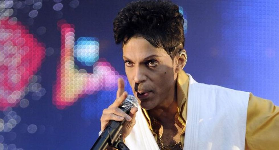 Prince turns from recluse to healer in Baltimore rally
