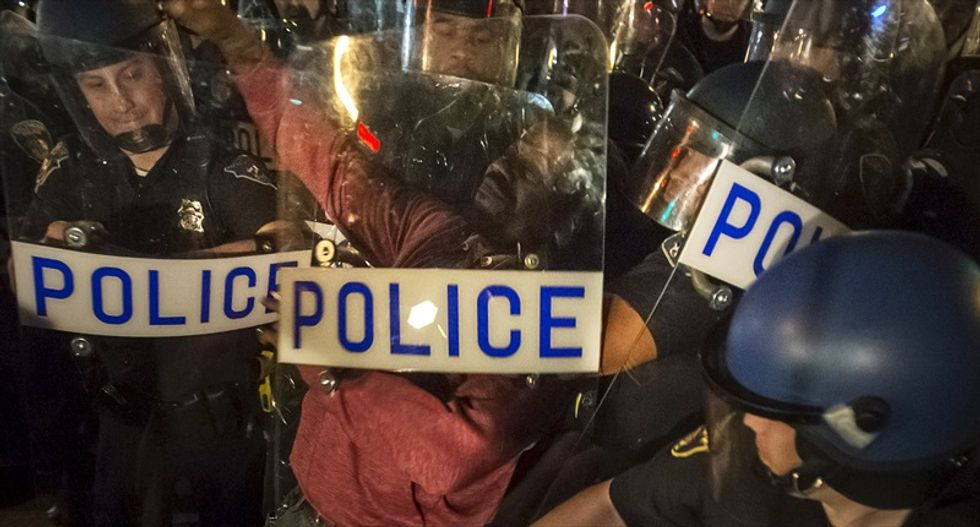 Video reveals Baltimore cops were looting during Freddie Gray protests