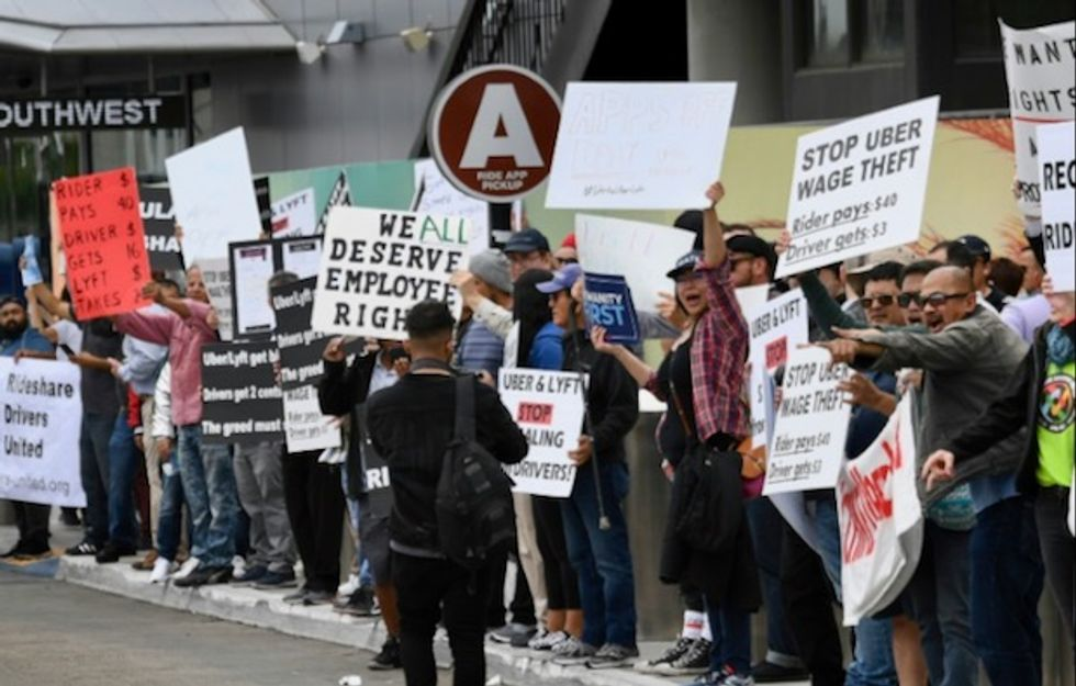 Rideshare drivers strike as Uber poised to go public